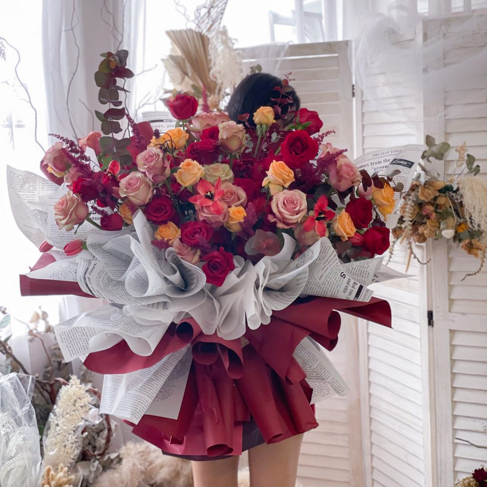 Premium Bouquet - Giant Size, a beautiful & classy hand bouquet with Imported roses, astilbe, tulips & eucalyptus.